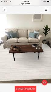 dark floor and beige sofa