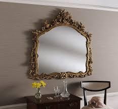 wall mirror with decorative leaf frame