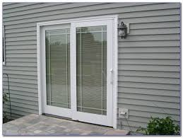 windows with blinds between glass