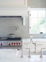 smoke glass subway tile white kitchen