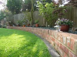 flower bed patio backyard brick