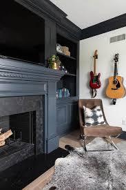 guitars over brown velvet tufted chair