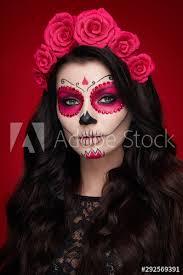 sugar skull makeup over red background