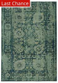 navy and green rugs at rug studio