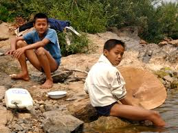 panning for gold in laos green around