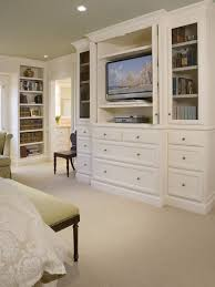 built ins to hide the tv in the bedroom