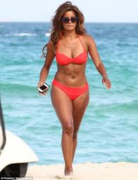 Claudia Johnson fires up her Miami beach break as she glamorously frolics  on the sand in a red bikini   Daily Mail Online