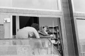 Jane Lanahan and Priscilla Price cleaning flood debris from museum office]  [picture]. | Office pictures, Corning museum of glass, Museum