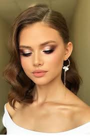 glam makeup brown curls and long earring