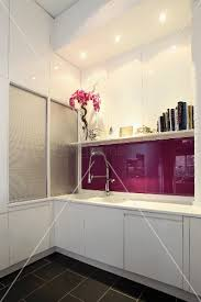 kitchen counter with white doors and