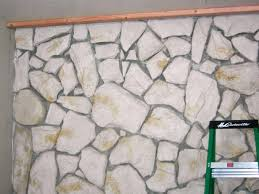build a standard wall over a stone wall