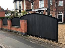 Ad Whitmore An Automated Composite Infilled Driveway Gate In A Vertical Pattern With Fence Panels To Match Lt Garage Doors Ltd