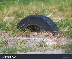 Old Car Tires Dug Into Ground Stock Photo Edit Now 1177451110