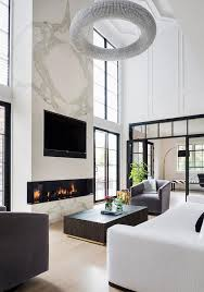 white marble fireplace with tv niche