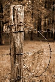 Fence Post And Barbed Wire In Sepia Stock Photo Picture And Royalty Free Image Image 3161050