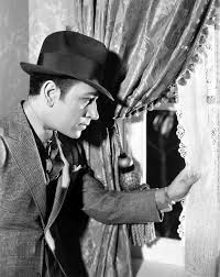 """George Raft in """"Midnight Club""""; 1933 at rusted shutter 