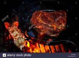 Steak and lobster on the grill Stock ...
