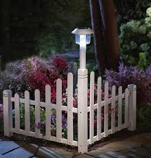 White Picket Fence Corner Lawn Edging W Solar Light This Would Be Easy To Make With Wooden Pickets Very Pretty For Front Yard Backyard Landscaping Backyard