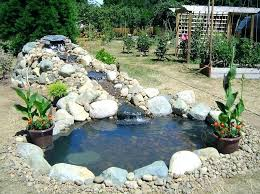fireplace patio pond waterfall garden