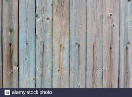 Part Of An Old Fence With Paint Residues On Dry Wooden Boards Old Nails Left Rust On Wood Grunge Wooden Fence Wall Background Texture And Place For Stock Photo Alamy