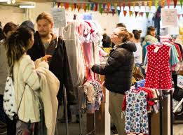 Shoppers at the Julie Baker stall at the Underground Market ...