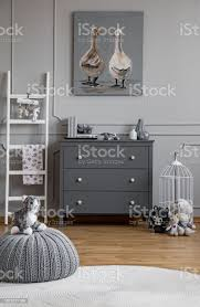 Pouf On Round Rug In Grey Kids Room Interior With Ladder Next To Poster And Cabinet Real Photo Stock Photo Download Image Now Istock
