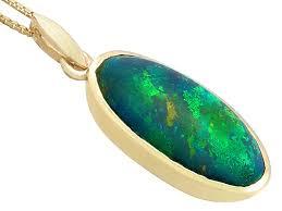 black opal pendant yellow gold
