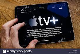 Paris, France - Mar 27, 2019: POV man reading on iPad Pro about Apple TV  Plus streaming service Stock Photo - Alamy