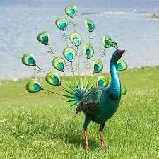 green peacock metal garden ornament