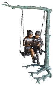 kids on swing set reading a book life