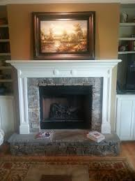 stone fireplace with raised hearth