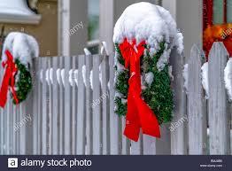 Christmas Wreaths On Picket Fence In Daybreak Utah Stock Photo Alamy
