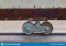 Rusty Wheels Of Fence Gate Of The House With Concrete Floor Stock Photo Image Of Fence Metal 131804646