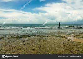 man silhouette horizon fishing rod
