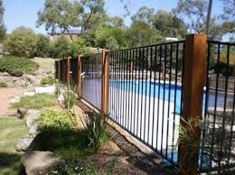 13 Latest And Elegant Wrought Iron Pool Fence Ideas Fence Around Pool Backyard Pool Landscaping Glass Pool Fencing