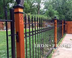 Using Wood Posts With Wrought Iron Fence For A Custom Look Iron Iron Fence Aluminum Fence Brick Fence