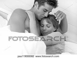 couple hugging in bed b w stock image