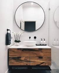black hardware and round mirror