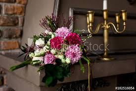 brown decorative fireplace with flower