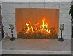 fireplace with logs removed and fire