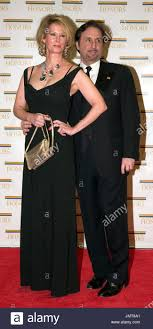 Ron Silver, right, and Catherine de Castelbajac arrive at the Harry Stock  Photo - Alamy