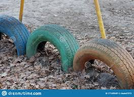 Decorative Fence From A Number Of Old Colored Car Tires Dug Into The Ground Stock Image Image Of Dirty Recycle 171499481