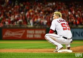 Washington Nationals catcher Jose Lobaton waits at first base for ...