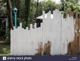 Uneven Boards In A Fence Are Partially Whitewashed With A Lamp Post Stock Photo Alamy