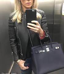 runs errands in celine leather jacket