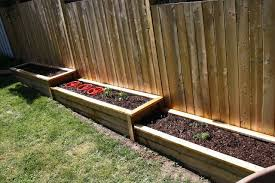 Definitely Linewill Easier Going Build These Along Fence Make Yard Work Much The To Sodefinit Building A Raised Garden Sloped Garden Garden Beds