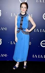 emma stone matches makeup to blue dress