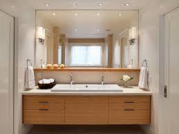 contemporary vanity below large mirror