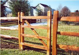 Wooden Slat Fence With Metal Posts For Support Rail Fence Wood Fence By Eads Fence Cincinnati Ohios Lea Wire And Wood Fence Fence Design Building A Fence
