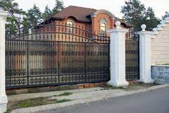 Black Iron Gate With Forged Pattern And White Brick Fence Stock Photo Image Of Black Building 166032934